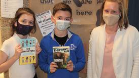 Troy students review newly released books for new online program