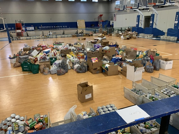 Newman annual food drive rakes in thousands of items for Sauk Valley food pantries