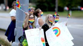 Alums, parents protest Benet Academy's decision to pull job offer to lacrosse coach after learning she was gay