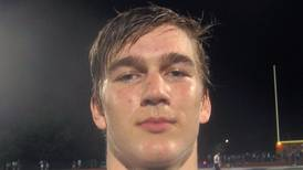 Karsten Libby's three TD catches in varsity debut highlight Wheaton North's 50-0 rout at Downers Grove South