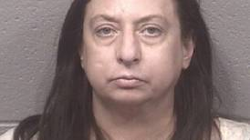 Genoa woman charged after police say she punched 75-year-old man during car show