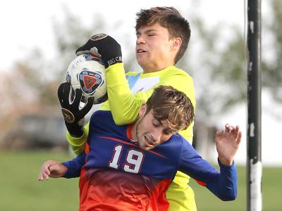 Photos: Genoa-Kingston and Marian Central Catholic meet on the pitch