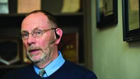 Schools superintendent Bob Sondgeroth closing the book and retiring