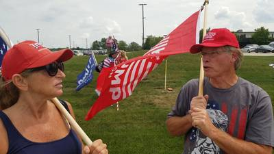 Protestors gather outside McHenry County College ahead of Biden's visit