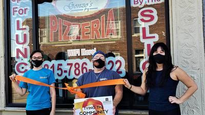 Ribbon tying at Gonzo's Rock N Roll Pizzeria