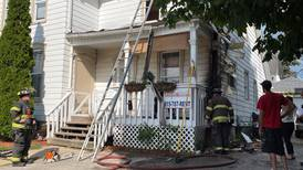 UPDATE: Fire at DeKalb duplex caused by 'improperly discarded smoking material'