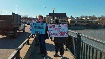 Supporters of Burns' re-election gather on State Street bridge in Geneva
