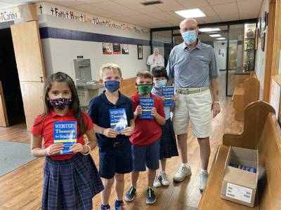 Photo: Mendota Rotary delivers thesauruses to Holy Cross students