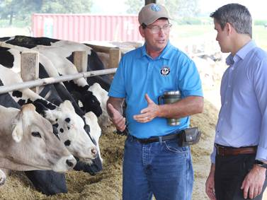 Photos: U.S. Congressman Adam Kinzinger visits Sycamore dairy farm