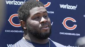 Bears tackle Eddie Goldman remains absent; Roquan Smith says he's not thinking about contract extension
