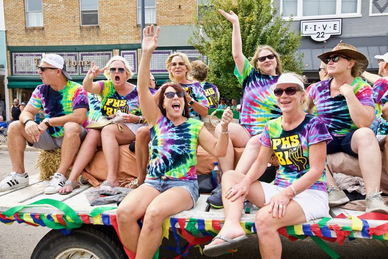 Members of a class float cheer and wave to the crowd during the 50th annual Homestead Festival Parade in Princeton on Saturday, Sept. 11, 2021.