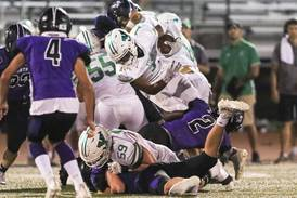 Kelly Watson's long TD run jolts slow-starting York past Downers Grove North in matchup of unbeatens