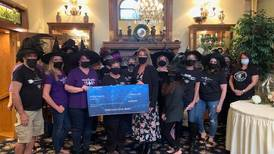 Joliet casino presents Witches Night Out committee with a check for nearly $4,300