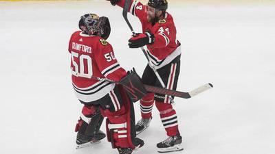 Blackhawks win Game 4 to advance to next round